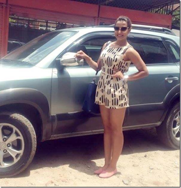 priyanka karki smiling near a car